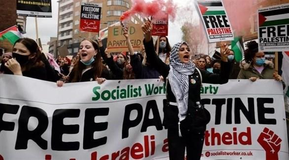 مشاركون في المسيرة (أ ف ب)