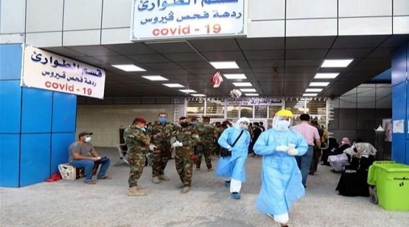 عراقيون في مستشفى لفحص كورونا (أرشيف)