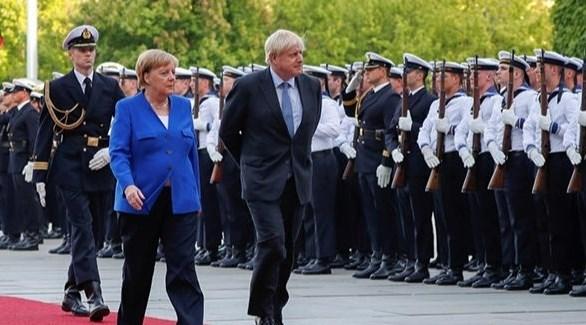 رئيس الوزراء البريطانس والمستشارة الألمانية (أرشيف)