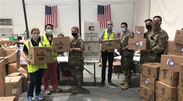 عسكريون ومتطوعون في الكويت يستعدون لاستقبال اللاجئين (تويتر)