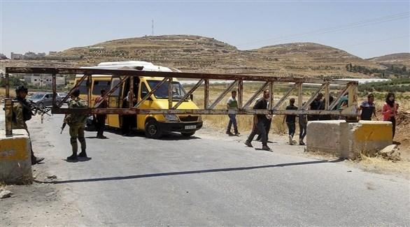 جنود إسرائيليون أمام خاجز في الضفة الغربية (ارشيف)