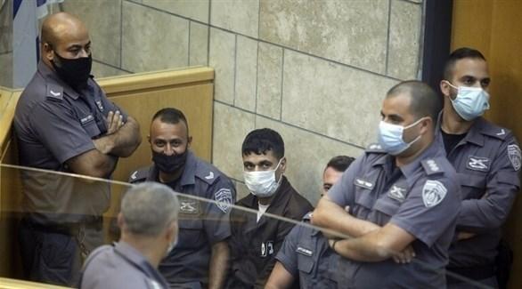 الأسير الفلسطيني محمود العارضة خلال جلسة محاكمة له (أرشيف)