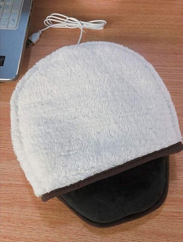 قاعدة فأرة كمبيوتر لبقاء اليد دافئة