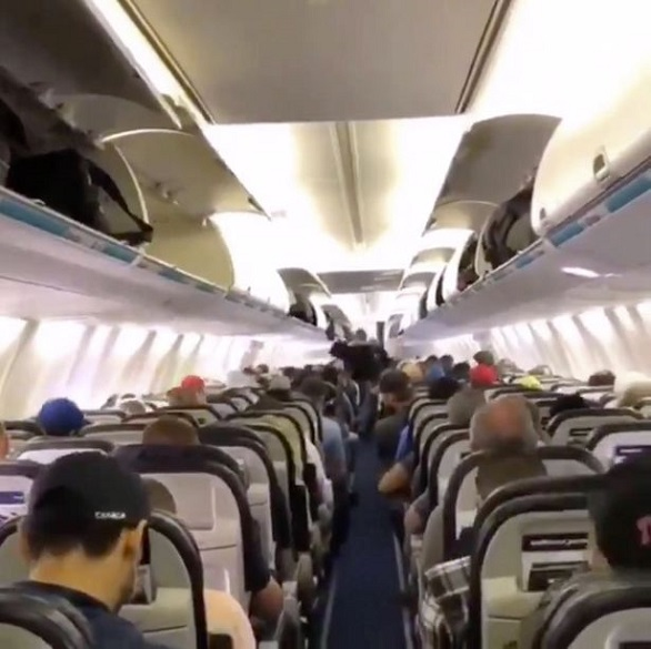 0_Airline-passengers-patiently-wait-to-d