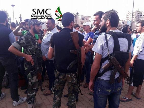 بالصور: بدء إجلاء مقاتلي المعارضة من حي الوعر في حمص  بالصور: بدء إجلاء مقاتلي المعارضة من حي الوعر في حمص